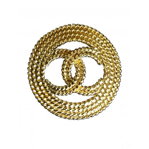 Złota broszka Chanel