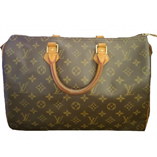 Elegancki kuferek Louis Vuitton