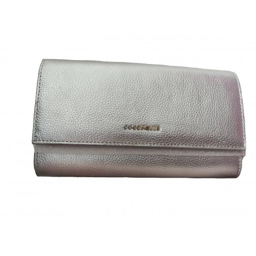 Nowa skórzana torebka kopertówka Coccinelle srebrna Metallic Soft Clutch