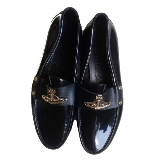 logo embellished loafers